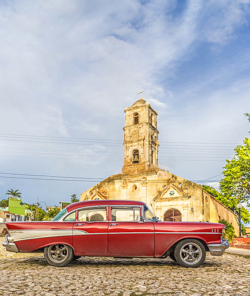 A vintage American car parked outside the Church of Santa Ana, Trinidad, UNESCO World Heritage Site, Cuba, West Indies, Caribbean, Central America