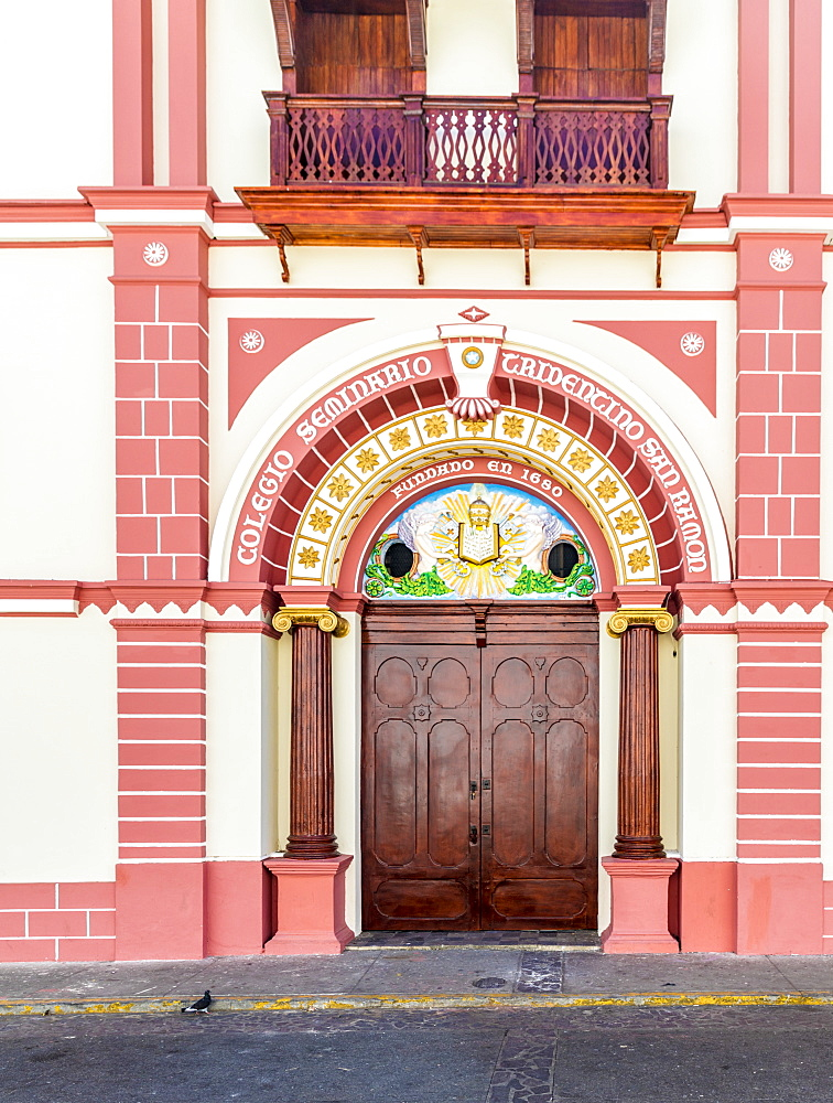 The colourful Renaissance influenced facade of the College of San Ramon by Central Park, Leon, Nicaragua, Central America
