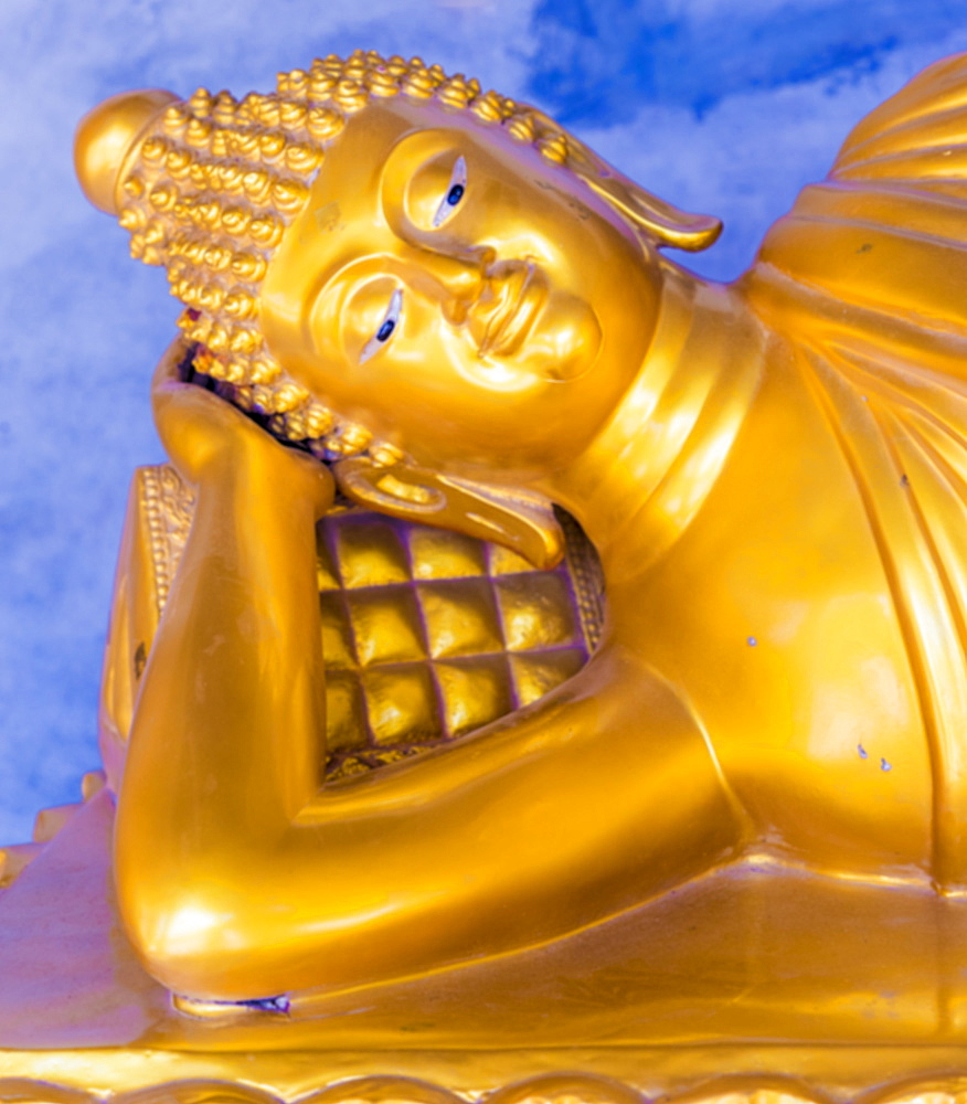 A gold Buddha in saiyat posture at the Big Buddha complex (The Great Buddha) in Phuket, Thailand, Southeast Asia, Asia