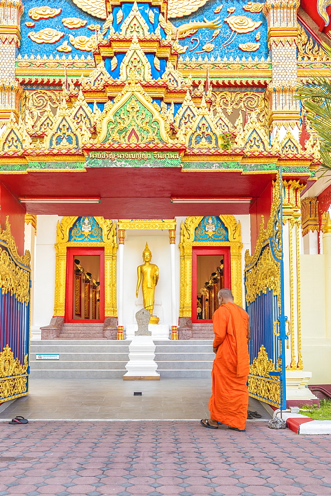 A monk at Mongkol Nimit temple (Wat) in Phuket old town, Phuket, Thailand, Southeast Asia, Asia
