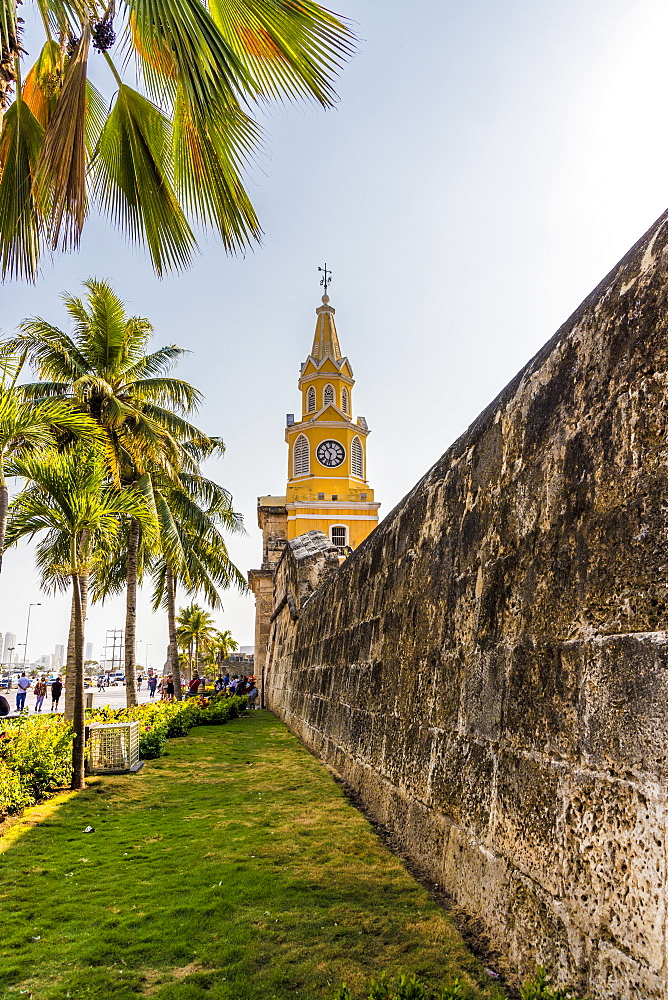 The colourful clock tower (torre del reloj) along the ancient city walls in Cartagena de Indias, Colombia, South America