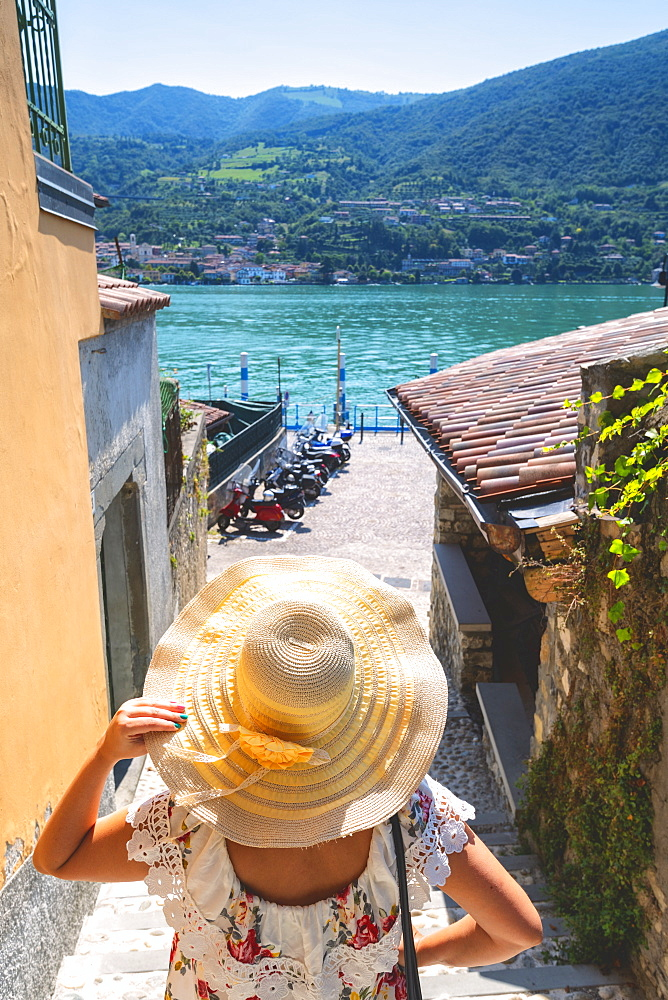 Woman with hat on Monte Isola, the largest lake island in Europe, Province of Brescia, Lombardy, Italy, Europe