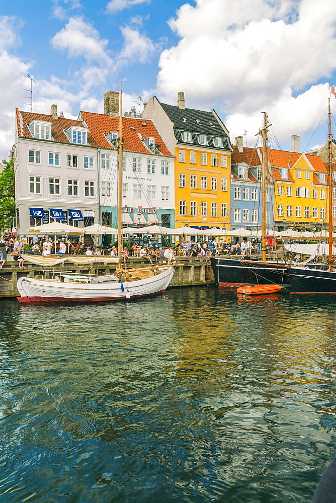Nyhavn in Kopenhagen with old colorful andhousesboats anchored in summer - 1300-230