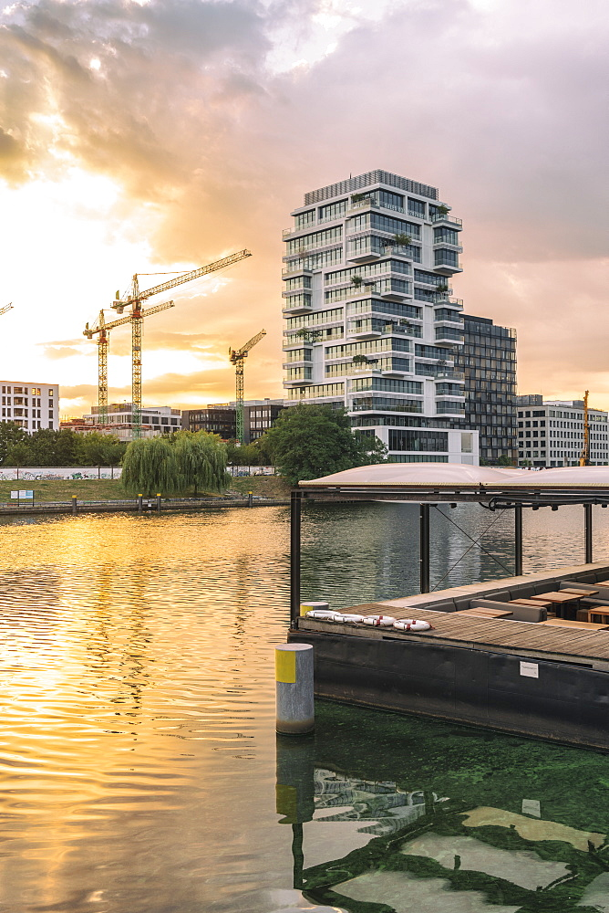 View of the Spree River after sunrise in Berlin with modern buildings on the background, Berlin, Germany, Europe