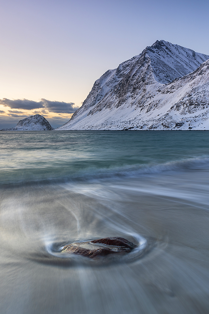Solitary stone on Haukland Beach in winter, Lofoten, Nordland, Arctic, Norway, Europe