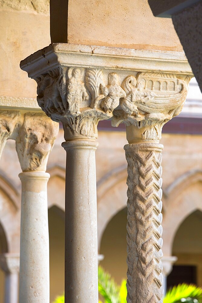Columns with finely carved capital in cloister of the UNESCO listed Arab-Norman cathedral, Cefalu, Palermo, Sicily, Italy - 1310-159
