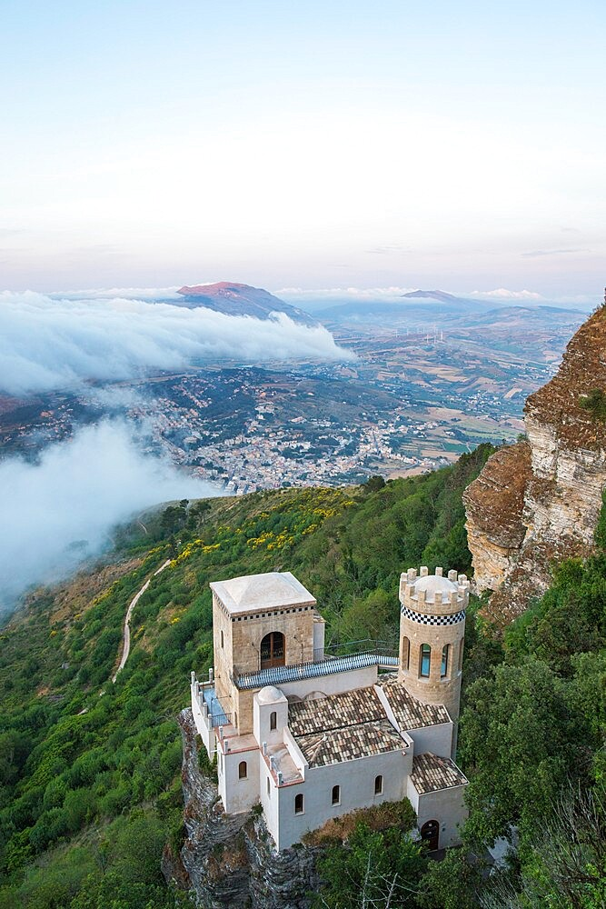 High angle view from clifftop over the Torretta Pepoli, clouds drifting across valley beyond, Erice, Trapani, Sicily, Italy