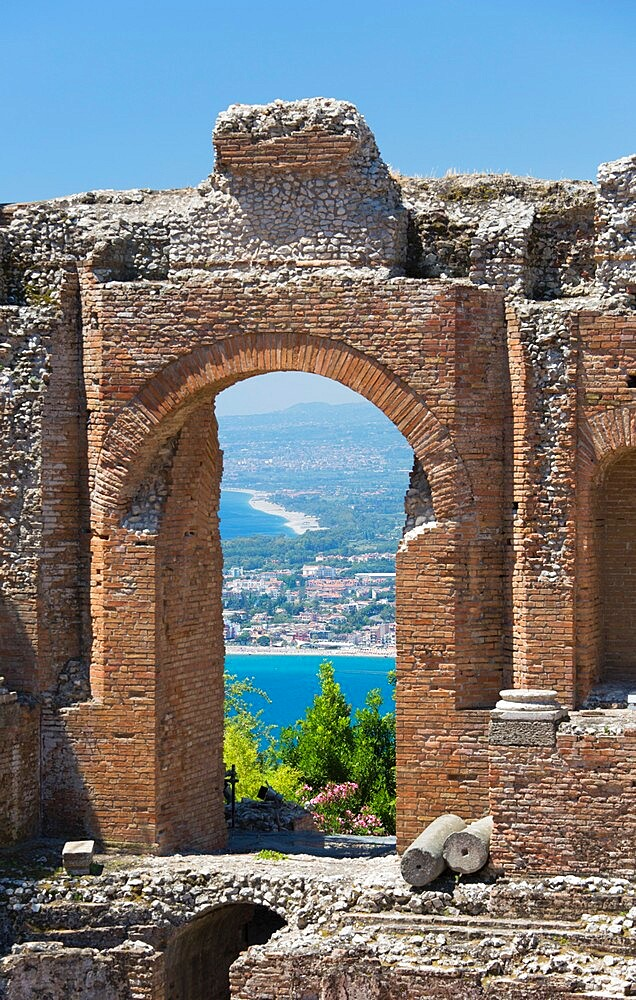 View from the Greek Theatre through arch to the Bay of Naxos, Taormina, Messina, Sicily, Italy - 1310-193