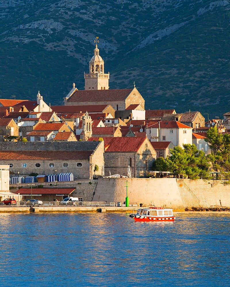 View to the Old Town at sunrise, ferry sailing into harbour, Korcula Town, Korcula, Dubrovnik-Neretva, Dalmatia, Croatia