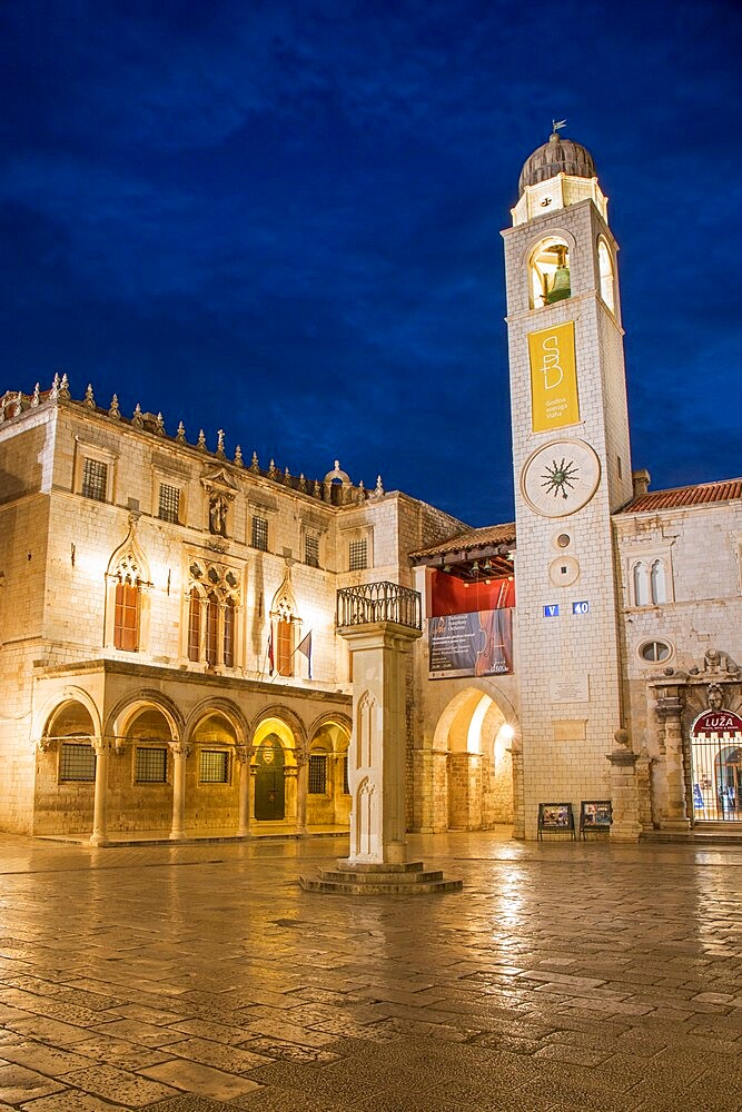 View across marble-paved Luza Square to the Sponza Palace and clock tower, dusk, Dubrovnik, Dubrovnik-Neretva, Dalmatia, Croatia, Europe