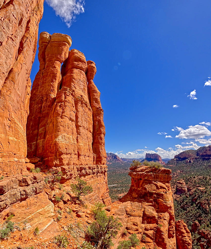 The centre Altar of Cathedral Rock, with Courthouse Buttes in the distance just above the flat altar rock in the centre, Sedona, Arizona, United States of America, North America