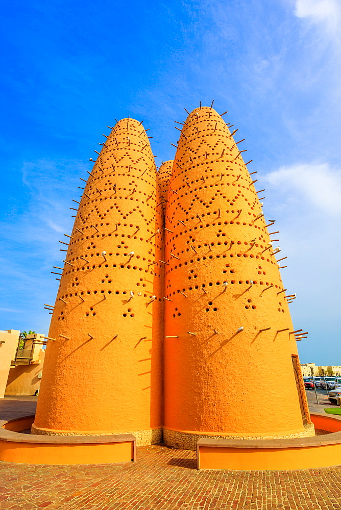 Pigeon towers and blue sky near Mosque in Katara, a cultural village (Valley of Cultures), West Bay, Doha, Qatar, Middle East
