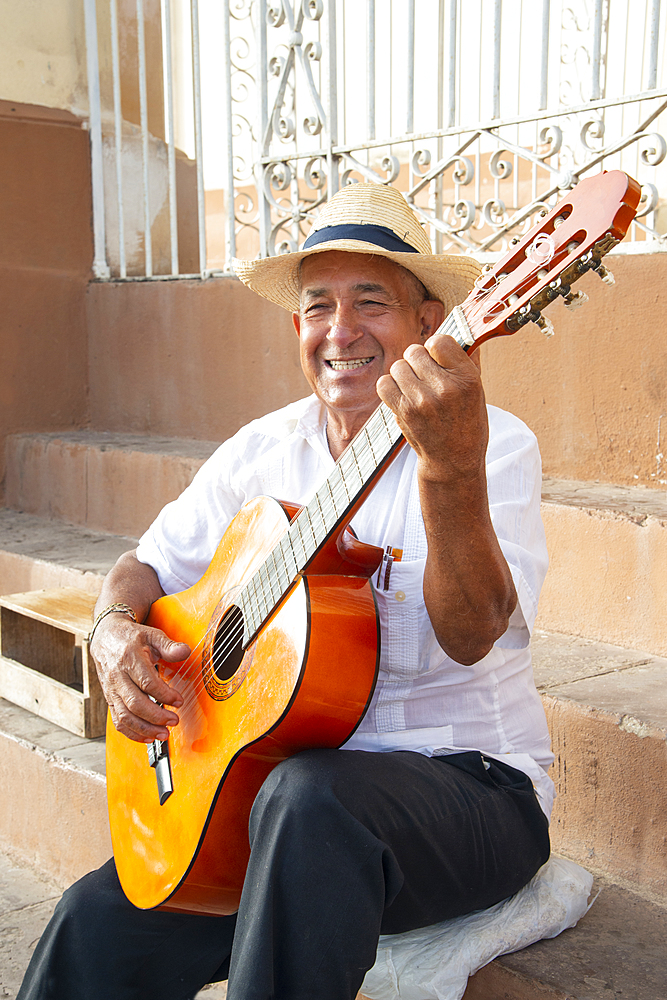 Local man singing and playing his guitar in the Plaza Mayor of Trinidad, Cuba, West Indies, Caribbean, Central America - 1315-104