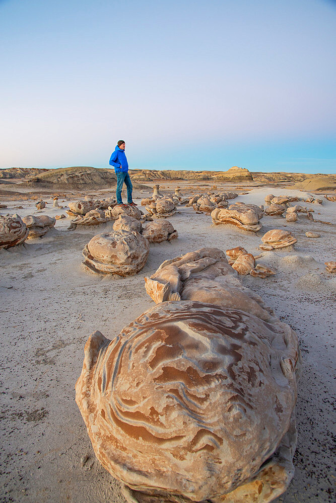 Exploring the 'cracked egg' sandstone formations of Bisti/De-Na-Zin Wilderness in New Mexico at sunset.