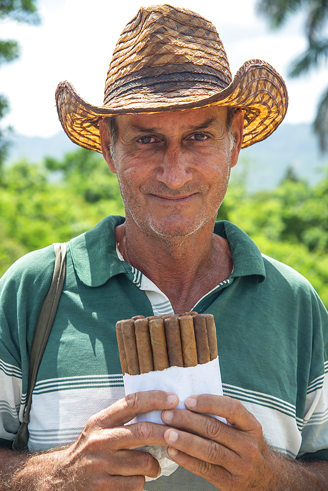 Local man selling Cuban cigars in Vinales, Cuba, West Indies, Caribbean, Central America