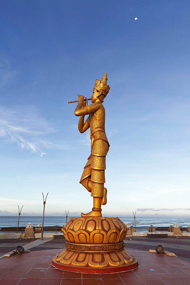 Portrait view of the Rakhine Nyut Phu statue, with the sea in the background and a third-quarter moon in the sky, Sittwe, Rakhine, Myanmar (Burma), Asia