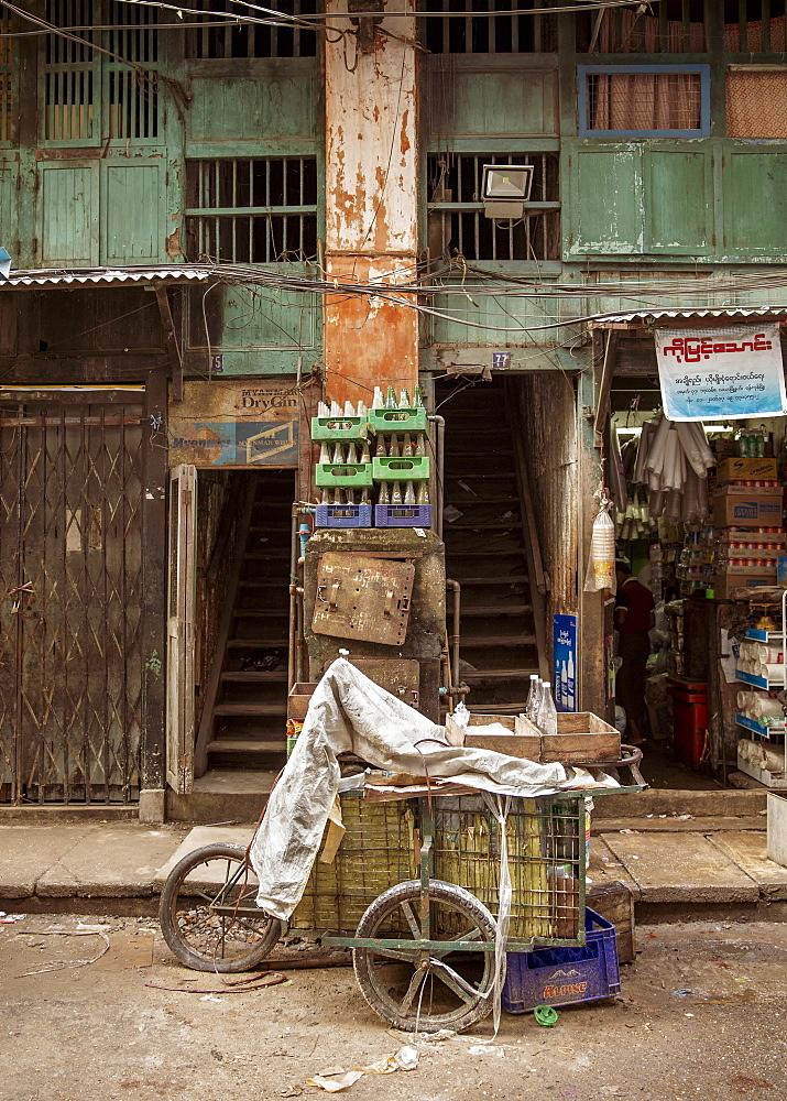 An old drinks cart outside an old building in Chinatown, Yangon (Rangoon), Myanmar (Burma), Asia