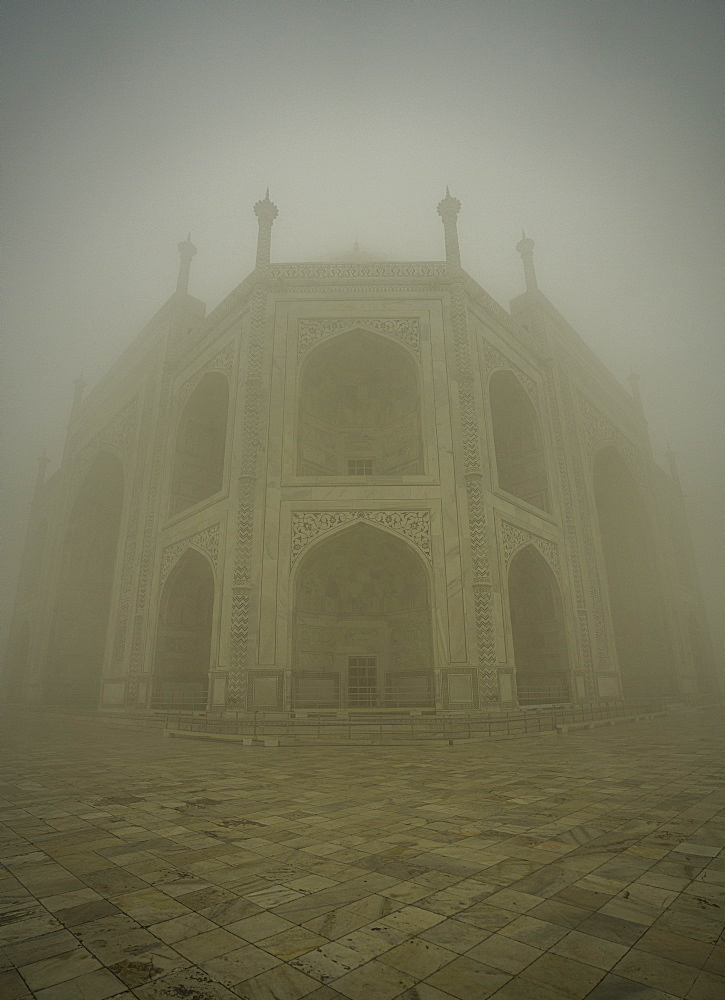 The Taj Mahal on a foggy morning. Agra, India - 1320-28