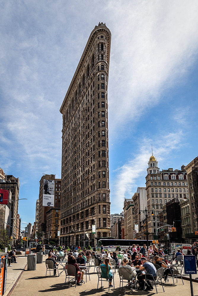 People gather at the Flatiron Building to drink coffee and take in the sun, Manhattan, New York, United States of America, North America