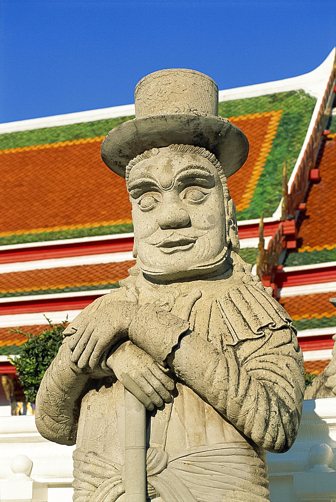 Close-up of a stone statue of a Farang guard at the temple of Wat Pho in Bangkok, Thailand, Southeast Asia, Asia