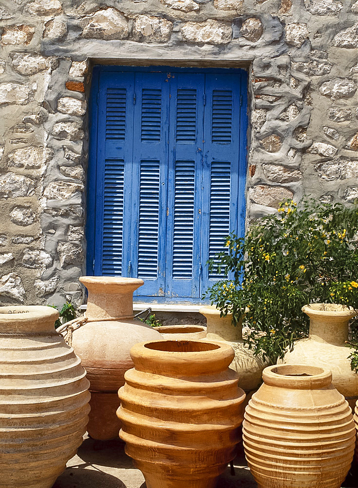 Greek urns in front of a blue door on Hydra, Argo Saronic Islands, Greece *** Local Caption ***