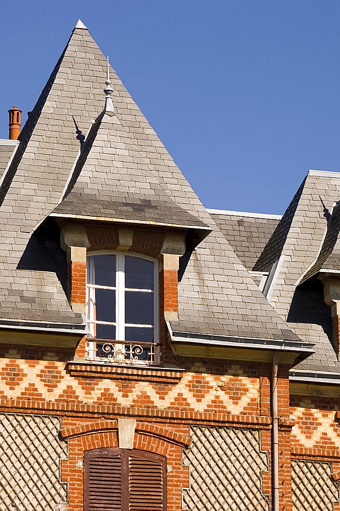 Elaborate brickwork on a house in the seaside town of Houlgate, Normandy, France, Europe