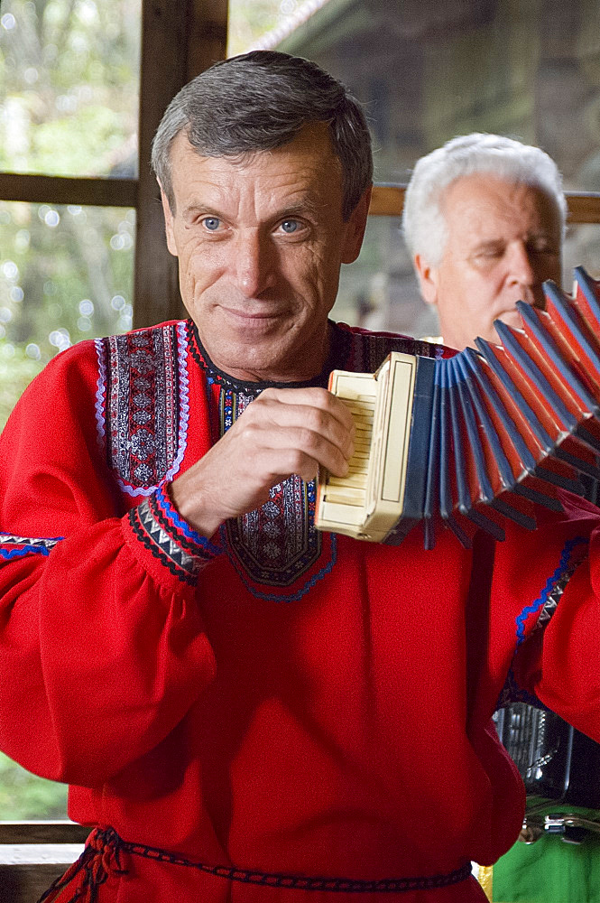 An accordian player in a Russian folk costume at the Dagomys Tea Plantation near Sochi, Russia, Europe