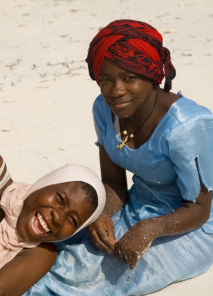 Local women in colourful dress on the beach, Paje, Zanzibar, Tanzania, East Africa, Africa