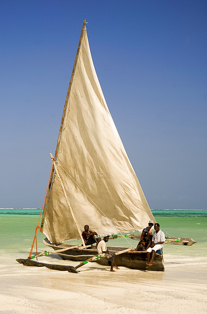 A traditional wooden sailing dhow on Kiwendwa Beach, Zanzibar, Tanzania, East Africa, Africa
