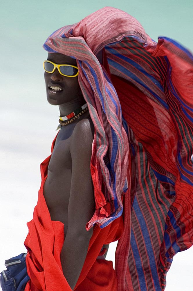 A Maasai tribesman on Paje Beach wearing colourful native dress, Paje, Zanzibar, Tanzania, East Africa, Africa