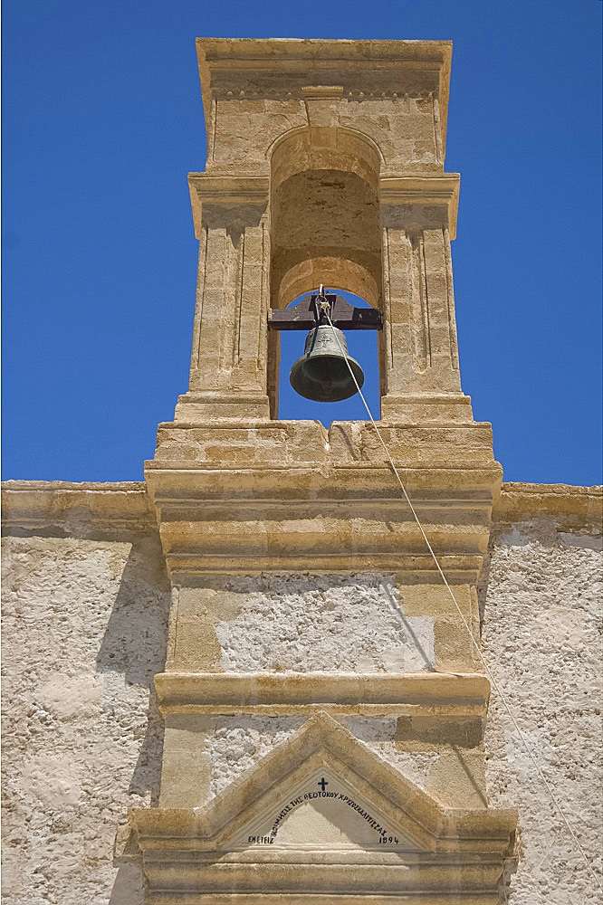 The belltower of the monastery of the Virgin of the Golden Step at Hrissoskalitissa on the coast of western Crete, Greek Islands, Greece, Europe