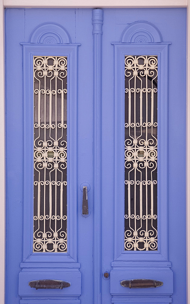 A traditional painted door with grille work in the village of Kritsa in eastern Crete, Greek Islands, Greece, Europe