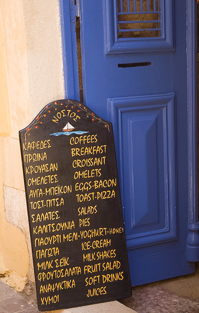 A chalkboard menu outside a taverna on a small back street in Hania, Crete, Greek Islands, Greece, Europe