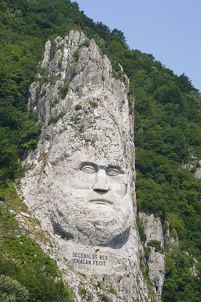 A rock sculpture of Decebalus, last prince of the Dracinians, on a hillside in the Kazan Gorge area of the Danube River, Romania, Europe - 149-5869