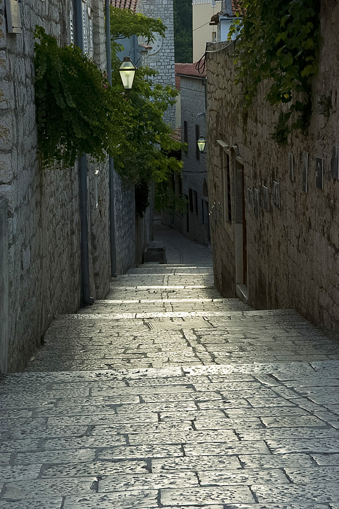 Worn stone steps between high walls in Rab Town, island of Rab, Kvarner region, Croatia, Europe