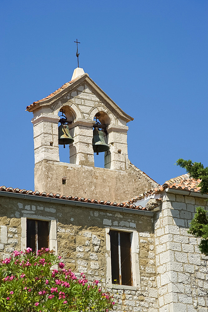 A bell tower at the Franciscan monastery of St. Eupehmia on the island of Rab, Kvarner region, Croatia, Europe