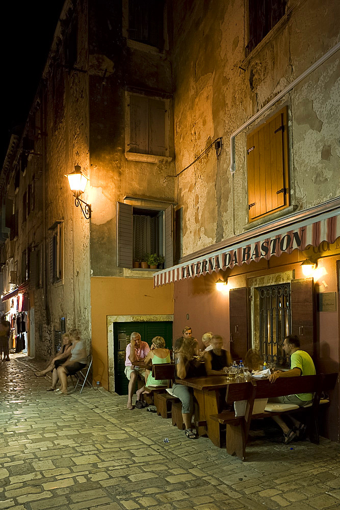 Restaurant tables on a small side street in Rovinj, Istria, Croatia, Europe