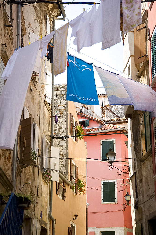 Laundry hanging in an alley of old buildings in Rovinj, Istria, Croatia, Europe