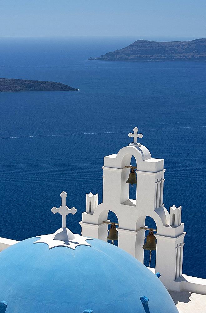 A blue domed Greek Orthodox church overlooking the sea in Firostefani, Santorini, The Cyclades, The Aegean, Greek Islands, Greece, Europe
