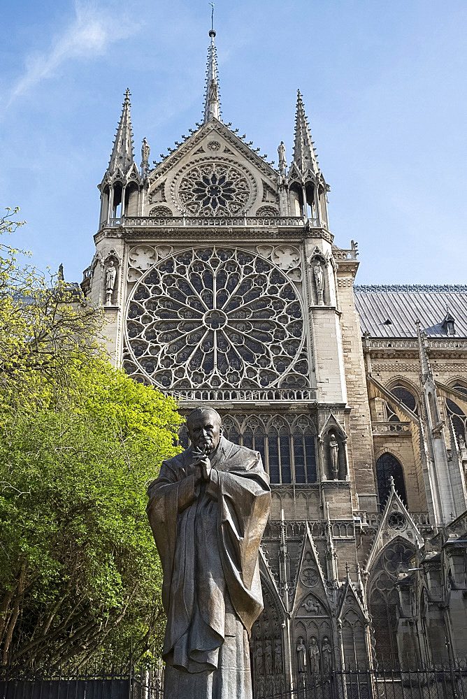 A statue of St. John Paul next to Notre-Dame Cathedral on the Ile de la Cite. Paris, France, Europe