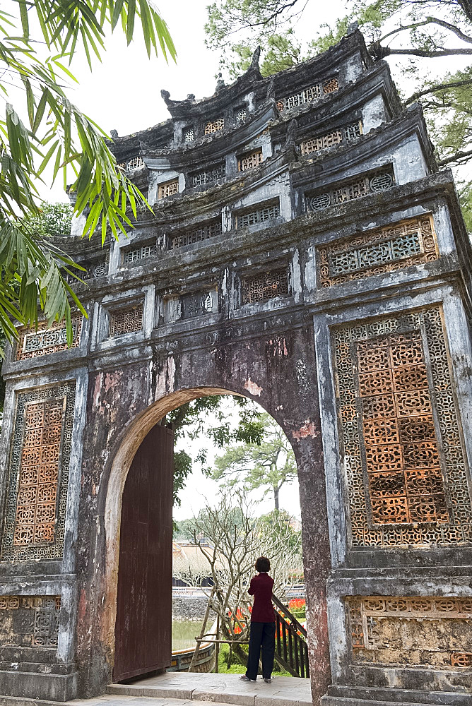 An ornately decorated gate in the grounds of the Tu Duc Tomb near Hue, Vietnam, Indochina, Southeast Asia, Asia