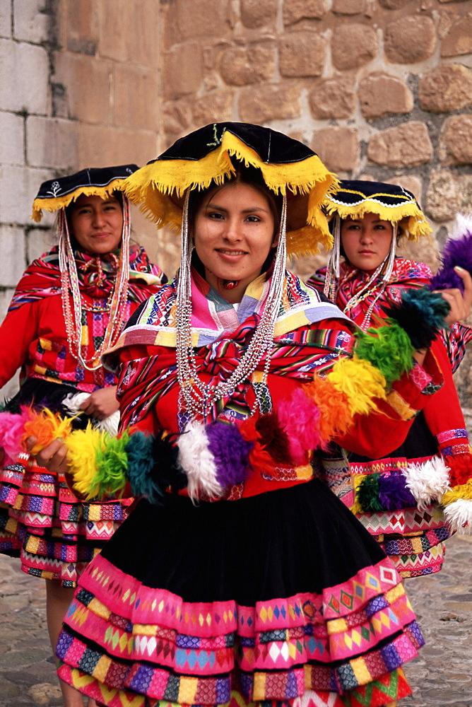 Portrait of three local Peruvian girls in traditional dance dress, looking at the camera, Cuzco, Peru, South America - 252-10474