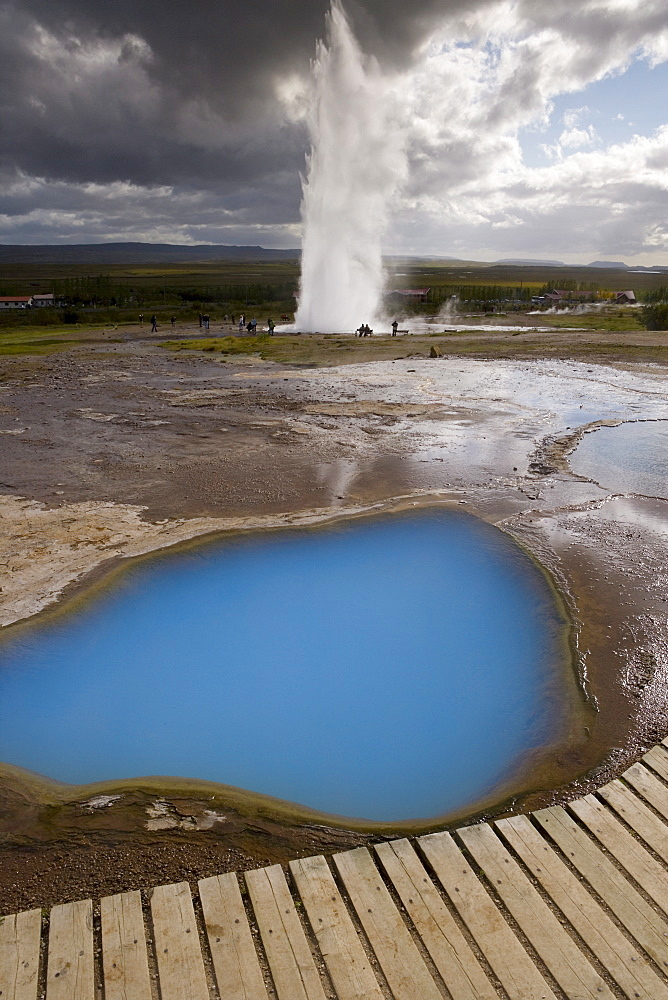 Strokkur (the Churn) which spouts up to 35 meters erupting every 10 minutes, Geysir, Golden Circle, Iceland, Polar Regions