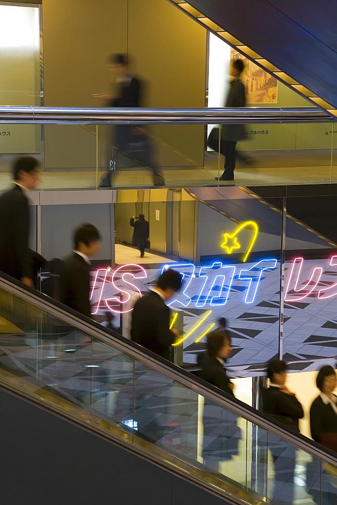 People on an elevator inside the Shinjuku NS Building, Shinjuku, Tokyo, Honshu, Japan, Asia