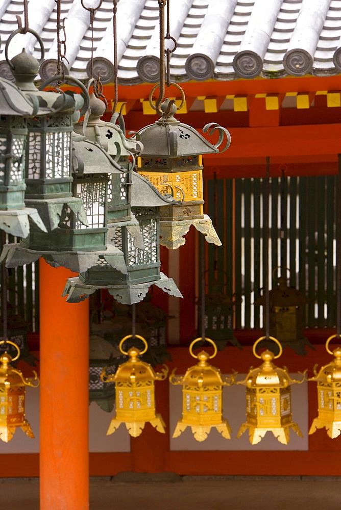 Detail of lanterns hanging outside Kasuga Taisha temple in Nara Koen, Nara, Kansai Region, Honshu, Japan, Asia