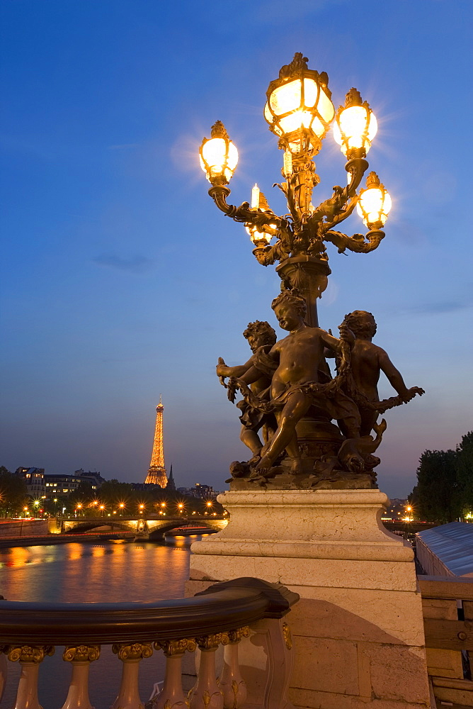 View of the Eiffel Tower from Pont Alexandre III at dusk, Paris, France, Europe