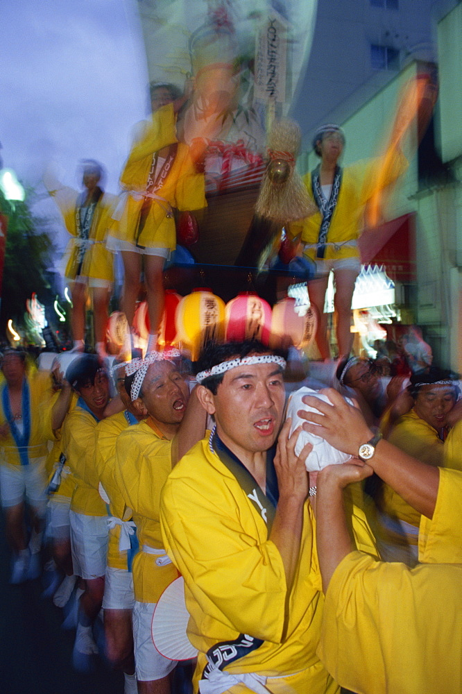 A group of men carrying a shrine during Mikoshi, portable shrine festival, in Asahikawa, Japan, Asia