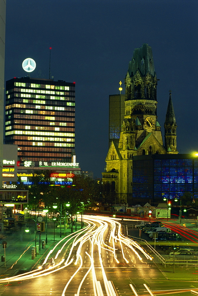 The Kaiser Wilhelm church and surrounding buildings illuminated at night on the Kurfurstendam in Berlin, Germany, Europe