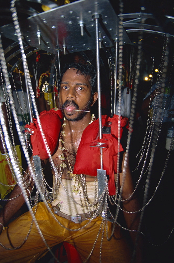 Man with pierced tongue at the annual Hindu festival of Thaipusam at the Batu Caves near Kuala Lumpur, Malaysia, Southeast Asia, Asia