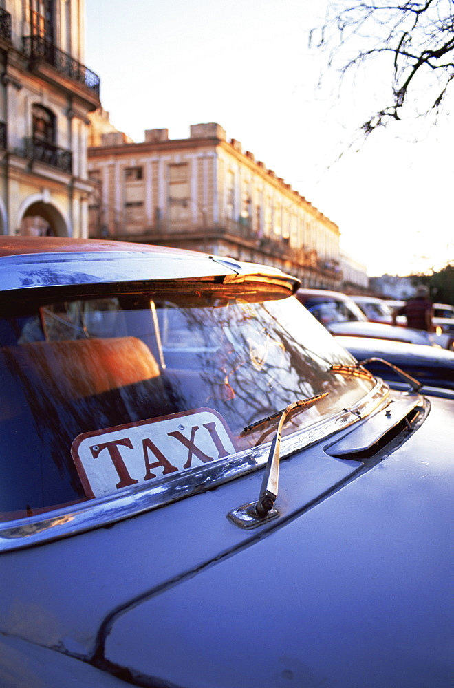Classic American car with Taxi sign in windscreen, Havana, Cuba, West Indies, Central America